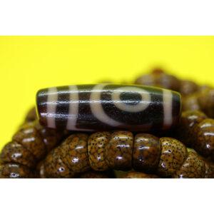Dzi bead 2 mắt thân ngọc A+