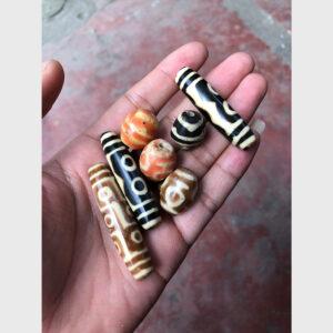 Dzi bead old plastic tròn và dài 5 mắt, bảo bình, 9 mắt, răng hổ